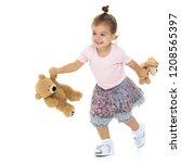 little girl with a teddy bear.... | Shutterstock . vector #1208565397
