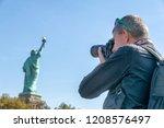 male photographer taking... | Shutterstock . vector #1208576497