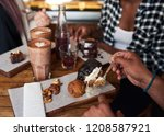 closeup of a young man eating a ... | Shutterstock . vector #1208587921