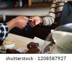 closeup image of hands of a... | Shutterstock . vector #1208587927