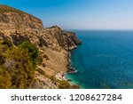 cliffs fall away to the sea... | Shutterstock . vector #1208627284
