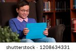 cute schoolboy uses the app on... | Shutterstock . vector #1208634331
