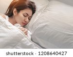 young asian woman sleeping... | Shutterstock . vector #1208640427