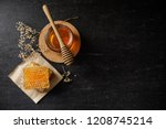 Honey Bee And Honeycomb With...