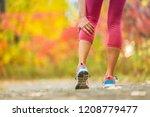 leg muscle cramp calf sport... | Shutterstock . vector #1208779477