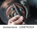 car mechanic or serviceman... | Shutterstock . vector #1208792524