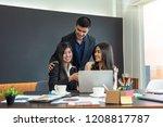 businessman touching two asian... | Shutterstock . vector #1208817787