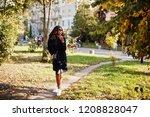 stylish african american girl... | Shutterstock . vector #1208828047
