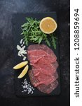carpaccio made of raw marbled...   Shutterstock . vector #1208859694
