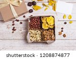 a box of nuts and dried fruits... | Shutterstock . vector #1208874877