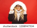 smiling blonde with caucasian... | Shutterstock . vector #1208947534
