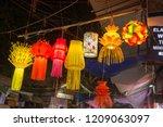 a streetside shop selling... | Shutterstock . vector #1209063097