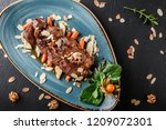grilled veal steak with nuts... | Shutterstock . vector #1209072301