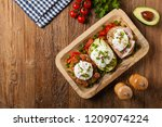 sandwiches with a poached egg.... | Shutterstock . vector #1209074224