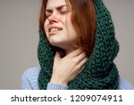 A Woman With A Sore Throat Is...
