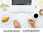 girl's hands holds golden pen.... | Shutterstock . vector #1209083494