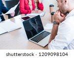 partial view of pensive... | Shutterstock . vector #1209098104