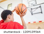 african boy with basketball in... | Shutterstock . vector #1209139564