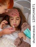 sick little girl | Shutterstock . vector #1209144871