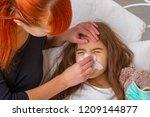 sick little girl | Shutterstock . vector #1209144877