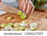 slices of leek on a wooden... | Shutterstock . vector #1209217507