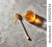 a puddle of honey on the table... | Shutterstock . vector #1209225214