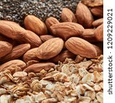 organic texture of almonds and... | Shutterstock . vector #1209229021