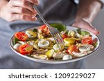 woman hands hold a fork with... | Shutterstock . vector #1209229027