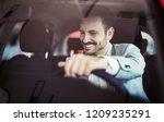 attractive happy young man... | Shutterstock . vector #1209235291