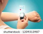 female hand with smartwatch and ... | Shutterstock . vector #1209313987