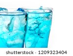 blue drink with ice cubes on... | Shutterstock . vector #1209323404