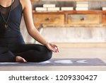 slender asian yoga girl wearing ... | Shutterstock . vector #1209330427