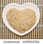 oatmeal in heart shaped plate | Shutterstock . vector #1209333781