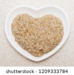 oatmeal in heart shaped plate | Shutterstock . vector #1209333784