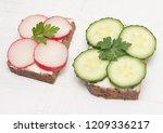 healthy open sandwiches on a... | Shutterstock . vector #1209336217