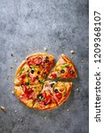 pizza on a dark gray background ... | Shutterstock . vector #1209368107
