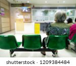 old woman sit on green chair... | Shutterstock . vector #1209384484