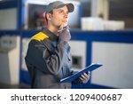 pensive industrial worker... | Shutterstock . vector #1209400687