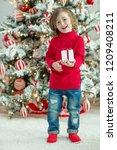 child on christmas | Shutterstock . vector #1209408211