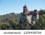dracula's castle on a sunny... | Shutterstock . vector #1209458704