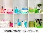 Bath accessories on shelfs in bathroom - stock photo