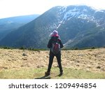 girl in the mountains | Shutterstock . vector #1209494854
