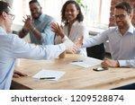 Smiling Business Partners Shak...