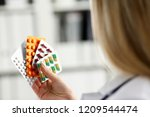 female doctor hand holding pack ... | Shutterstock . vector #1209544474