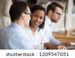 multiracial colleagues talk... | Shutterstock . vector #1209547051