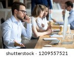 angry male employee confused... | Shutterstock . vector #1209557521