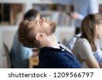 tired male employee throw head... | Shutterstock . vector #1209566797