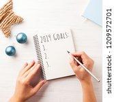 woman's hand writing 2019 goals ... | Shutterstock . vector #1209572701
