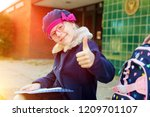 beautiful blonde girl showing... | Shutterstock . vector #1209701107