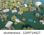 Small photo of tons of homes totally destroyed , flooded and submerged under water , Historic Flooding aerial drone view above Homes and Houses Central Texas Flooding severe weather and climate change flooding